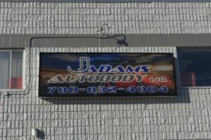J Adams Sign Can